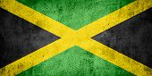 pic of jamaican flag  - flag of Jamaica or Jamaican banner on rough pattern texture background - JPG