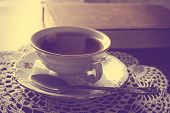 pic of poetry  - Cup of tea with poetry book on napkin in vintage effect - JPG