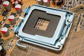 stock photo of processor  - Empty CPU processor socket with pins on motherboard