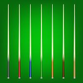 picture of realism  - Set of 7 different billiard cues on a green background - JPG