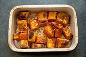 pic of pot roast  - Roasted pumpkin in a ceramic pot on a black slate background - JPG