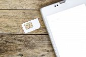 stock photo of micro-sim  - smart phone use with micro sim card white screen - JPG