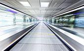 pic of escalator  - symmetric moving blue escalator inside contemporary airport - JPG