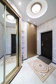 stock photo of wardrobe  - Interior hallway with entrance door and sliding mirror wardrobe - JPG