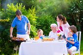 stock photo of retirement age  - Grill barbecue backyard party - JPG