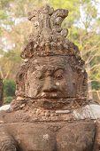 picture of serpent  - Stone Asura demons hold the naga serpent king Vasuki on the bridge entrance to Angkor Thom Cambodia - JPG