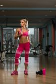 stock photo of jump rope  - Middle Age Womane Playing Around With Jumping Rope As Part Of Bodybuilding Training - JPG