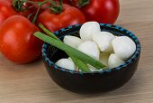 picture of shredded cheese  - Mozzarella cheese balls with onion and tomato branch - JPG