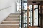foto of elevators  - Stairs and elevator in modern business office - JPG