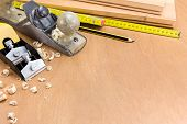 pic of shaving  - Set of carpenter working tools on wood and shavings - JPG