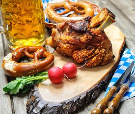 stock photo of pretzels  - Roasted pork knuckle with pretzels and beer - JPG