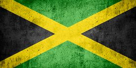 foto of jamaican flag  - flag of Jamaica or Jamaican banner on rough pattern texture background - JPG