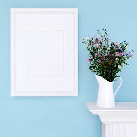image of wildflowers  - Mock up empty frame and wildflowers on blue wall background - JPG