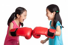 picture of identical twin girls  - Happy Asian twins girls with boxing gloves isolated on white background - JPG