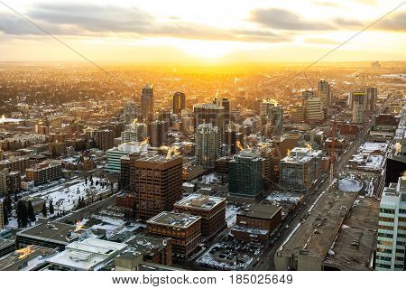 poster of Calgary City Urban Sunset. Sunset over the city of Calgary in winter. Taken from the Calgary Tower overlooking the south-west downtown side of the urban city.
