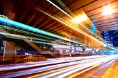 image of traffic light  - light trails in mega city - JPG