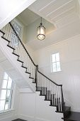 picture of wainscoting  - curved staircase in expensive home with white woodwork - JPG