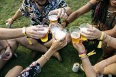 Group of Friends Drinking Beers Enjoying Music Festival Together poster