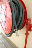 picture of firehose  - Red fire hose reel for emergency firefighting - JPG