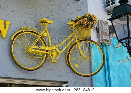 Old Style Yellow Bicycle On