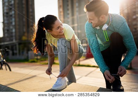 poster of Runners Tying Running Shoes And Getting Ready To Run