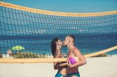 Love And Flirting Of Couple. Sexy Woman And Muscular Man With Ball At Net. Summer Vacation And Trave poster