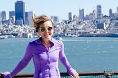 Portrait Of A Woman In Front Of The San Francisco Skyline, As Seen From The Water In The Bay. Wind B poster