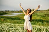 Happy  and serene behavior woman  outdoor with raised hands. cheerful girl is on nature over the spr poster