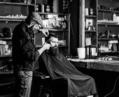 Hipster Client Getting Haircut. Haircut Concept. Barber With Hair Clipper Works On Hairstyle For Man poster