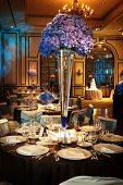 stock photo of flower arrangement  - Table setting at a luxury wedding reception in a large ballroom - JPG