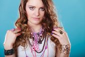 Pretty Young Woman Wearing Bracelets Rings And Many Plentiful Of Precious Jewelry Necklaces Beads. G poster