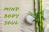 Flat Lay Composition Of Bamboo Stems With Zen Stones And Text Mind, Body, Soul On Sand poster