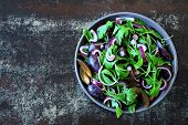 Healthy Salad With Arugula, Plum And Blue Onions In A Bowl On A Stylish Shabby Background. Vegan Bow poster