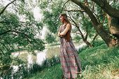 Young Hippie Woman On A Walk Near The Lake poster