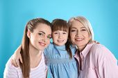 Beautiful Mature Woman With Daughter And Grandchild On Color Background poster
