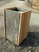 Rubbish bin with slate sides