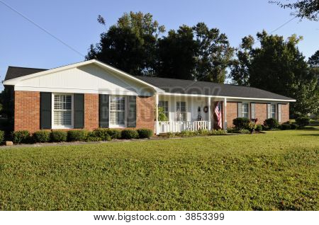 Picture or photo of red brick white trim and black for Brick houses without shutters