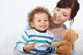 picture of babysitting  - Woman playing with her child - JPG
