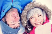 Happy winter couple. Cropped view of the faces of a joyful young interracial Asian / Caucasian coupl