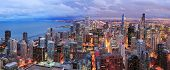 stock photo of illinois  - Chicago skyline panorama aerial view with skyscrapers over Lake Michigan with cloudy  sky at dusk - JPG