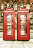 Antique red phone cabins, a worldwide known symbol of  London poster