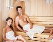 image of sauna  - Happy couple having a steam bath in a sauna - JPG