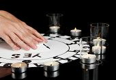 image of ouija  - spiritualistic seance by candlelight close - JPG