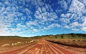 Dirt road on volcanic landscape of Plaine des Sables, Reunion Island National Park.