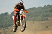 foto of dirt-bike  - motocross bike in a race representing concept of speed and power in extreme man sport - JPG