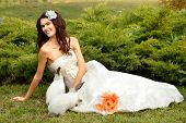 stock photo of alice wonderland  - Young woman bride smiling playing with cute rabbit over park summer nature outdoor - JPG