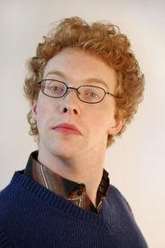 image of snob  - A snobbish nerd looking very uptight into the camera - JPG