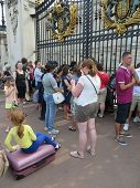 People Eager To Find Out About The Gender Of The Royal Baby Outside Buckingham Palace, In London 22N