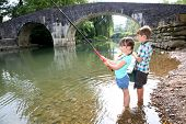 Kids enjoying fishing time in beautiful river
