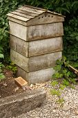 foto of beehives  - Wooden beehive a home for bees who pollinate local trees and flowers whilst producing honey which is collected by the beekeeper - JPG